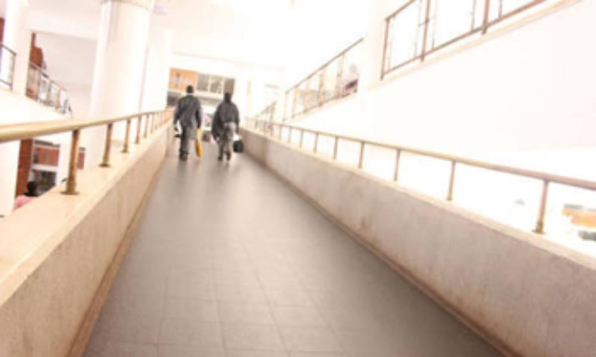 Two men on a walkway in Uganda