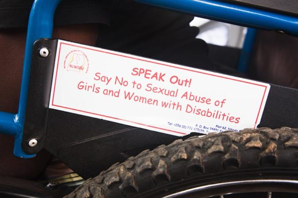 Sign on wheelchair, speak out, say no to sexual abuse of girls and women with disabilities.